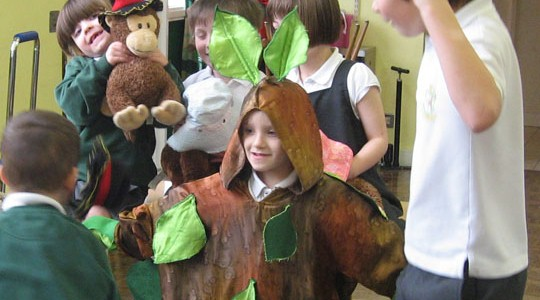 A photo of a child dressed as a tree