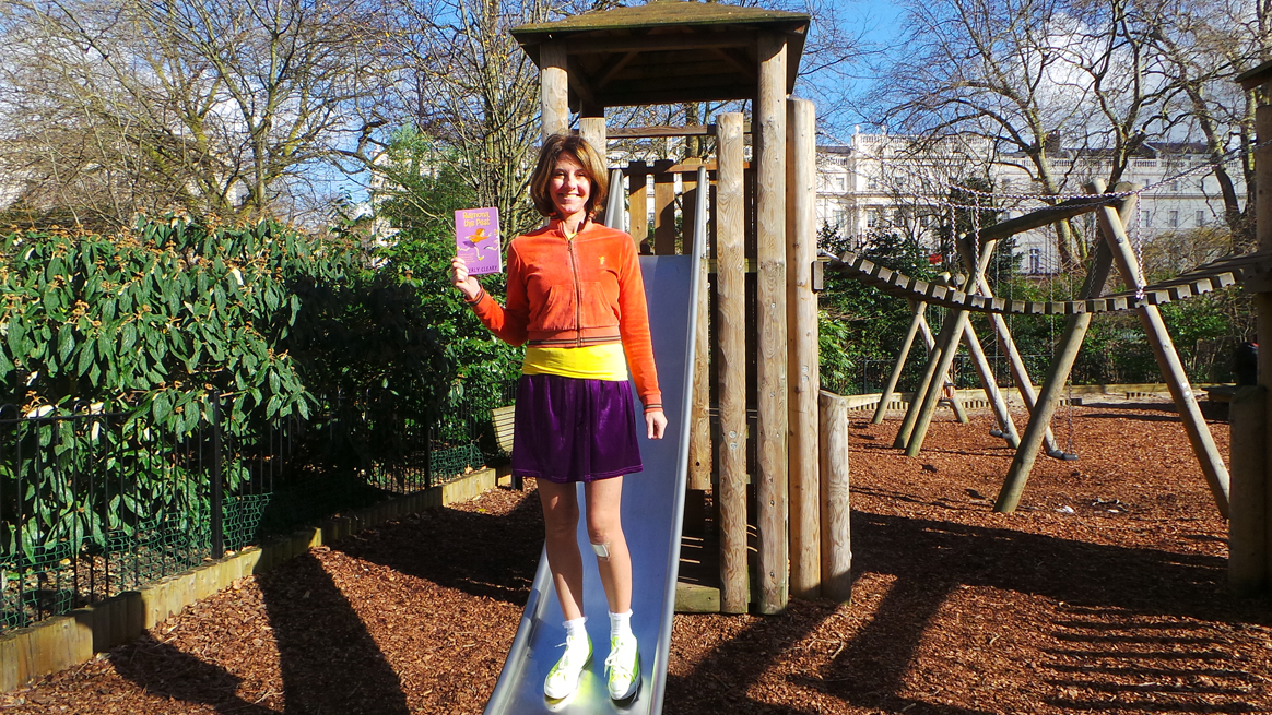 A photo of Elena Bowes in a playground dressed up as Ramona the Pest
