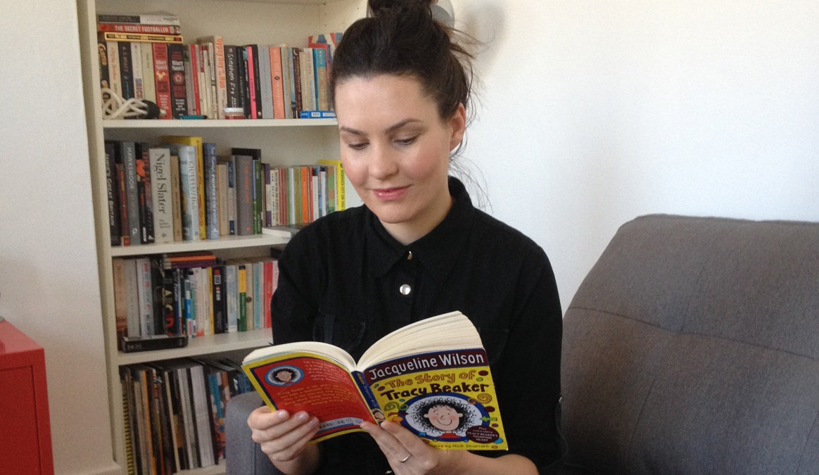 A photo of Laura Hunter reading Jacqueline Wilson's The Story of Tracy Beaker
