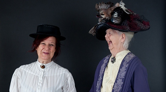 A photo of Shirley Hughes and Clara Vulliamy dressed as Lady Bracknell and Miss Prism from The Importance of Being Earnest by Oscar Wilde