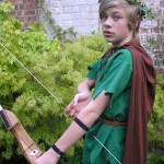 A boy poses as Legolas from The Lord Of The Rings