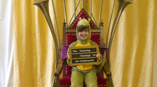 Visitor Clement sits on the talking throne