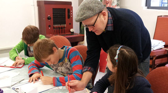 children drawing with Neill Cameron