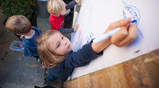 Children drawing outside